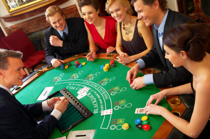 Group of people playing blackjack